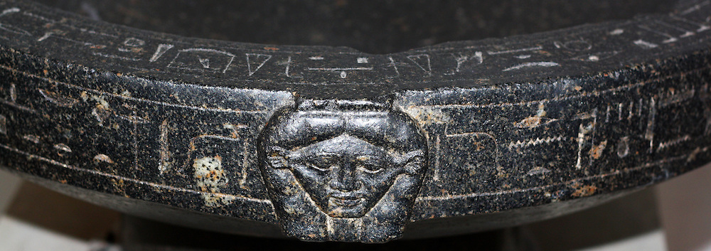 Granodiorite Basin of Montuemhat. 25th or 26th Dynasty (approx. 670-650 BC) Egyptian. Possibly from Thebes. The basin shows the Goddess Hathor on one side, with the reverse showing Montuemhat & Hathor (or possibly Mut) demonstrating Montuemhat's piety.