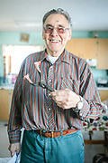 Danny Gordon holds a pair of muskrat tails twisted together to hang and dry. Danny, an 81-year-old Aklavik resident still gets out on the land to hunt every summer.