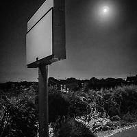 night scene with street sign