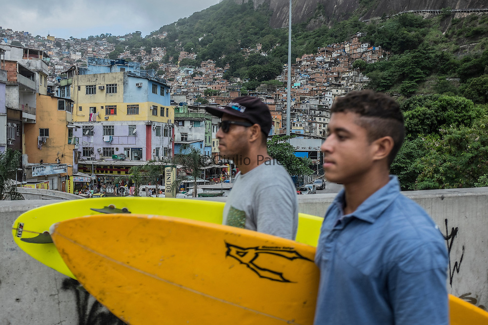 "José Ricardo ""Bocão"", 44, surfer, social activist. He founded Rocinha Surfe Escola in late 80s, when some kids used to see him with a surfboard and ask him to teach them. The surf school survives with financial and equipment donations as well as volunteers' help. Hundreds of children learned how to surf and, through this sport along with Portuguese, English, skateboard and theatre classes – so they can keep their minds pretty busy, not giving a chance to get stuck in a life of crime."