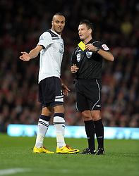 Younes Kaboul gets the Yellow Card from Referee Mark Clattenburg during the Barclays Premier League match between Manchester United and Tottenham Hotspur at Old Trafford on October 30, 2010 in Manchester, England.