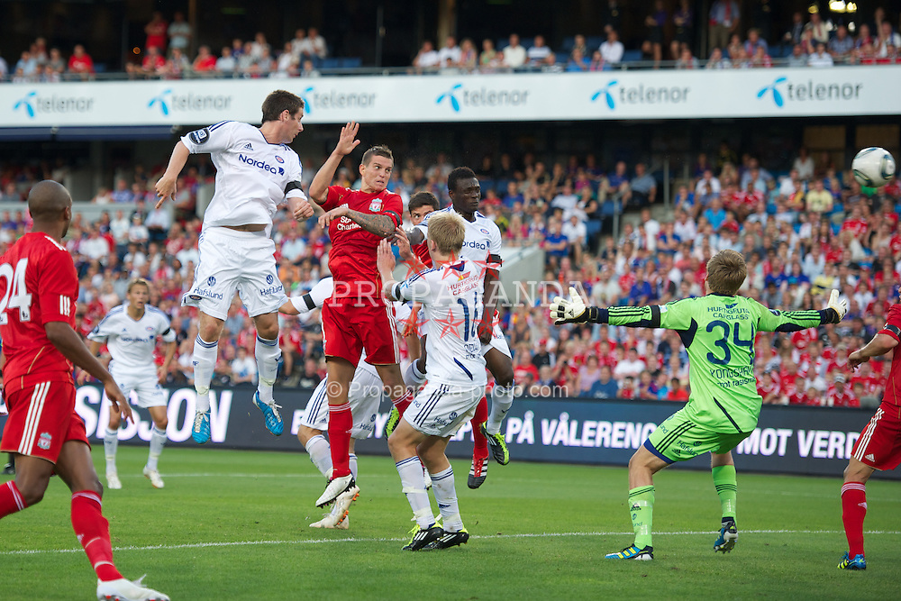 OSLO, NORWAY - Monday, August 1, 2011: Liverpool's Daniel Agger scores the first goal against Valerenga during a preseason friendly match at the Ulleval Stadion. (Photo by David Rawcliffe/Propaganda)
