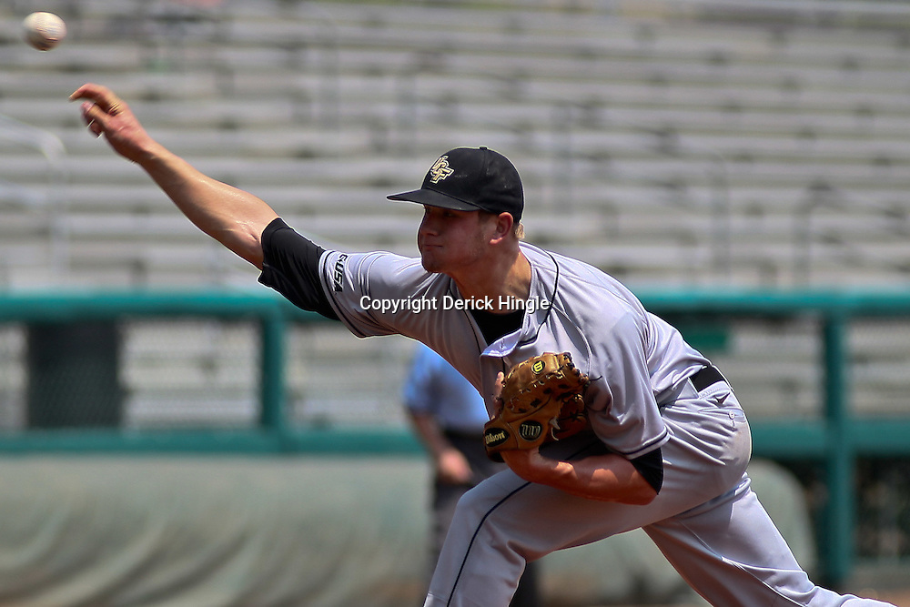 June 05, 2011; Tallahassee, FL, USA; UCF Knights pitcher Ben Lively (11) throws against the Alabama Crimson Tide during the first inning of the Tallahassee regional of the 2011 NCAA baseball tournament at Dick Howser Stadium. Mandatory Credit: Derick E. Hingle