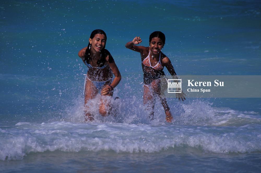 Girls in bikini in the water (MR), Copacabana Beach, Rio de Janeiro, Brazil