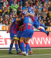 FC Basel midfielder Valentin Stocker (L) is being celebrated by his teammates Benjamin Huggel (no. 8) and David Angel Abraham (R) after scoring to the score of 0-1 during the Super League (National League A) soccer match between BSC Young Boys (YB) and FC Basel (FCB) at the Stade de Suisse stadium in Bern, Switzerland, Sunday, Mai 16, 2010. FC Basel have won the Swiss football championship beating Young Boys of Bern 2-0 in the last match of the season. (Photo by Patrick B. Kraemer / MAGICPBK)