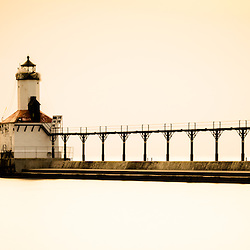 Panorama picture of Michigan City lighthouse at sunset. The Michigan City East Pierhead Lighthouse is located in Michigan City, Indiana along the Lake Michigan shoreline.