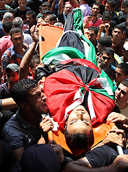60372638<br /> Palestinians carry the body of Majed Lahlouh during his funeral in the West Bank city of Jenin on Tuesday Aug. 20, 2013. Lahlouh was killed early Tuesday in clashes with Israeli forces that raided north West Bank, medical and security sources said, Tuesday August. 20, 2013.<br /> Picture by imago / i-Images<br /> UK ONLY