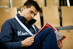 Klemen Cehte reads Euro magazine during the Men's Handball European Championship Main Round match between Slovenia and Czech republic at the Olympia Hall on January 24, 2009 in Innsbruck, Austria.  (Photo by Vid Ponikvar / Sportida) - on January 2010