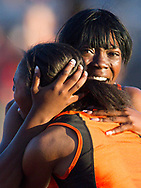 April 11, 2014 - Vacaville's Nia Vance and Pattriana Perry celebrate after beating the national record for the 4x100 Meter Shuttle Hurdle event completing the race in 57.17 seconds at the Arcadia Invitational in Arcadia, CA.
