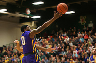 Great Danes guard Evan Singletary (0) leaps for a lay up during the men's basketball game between the Albany Great Danes and the Vermont Catamounts at Patrick Gym on Wednesday night January 28, 2015 in Burlington, Vermont. (BRIAN JENKINS, for the Free Press)