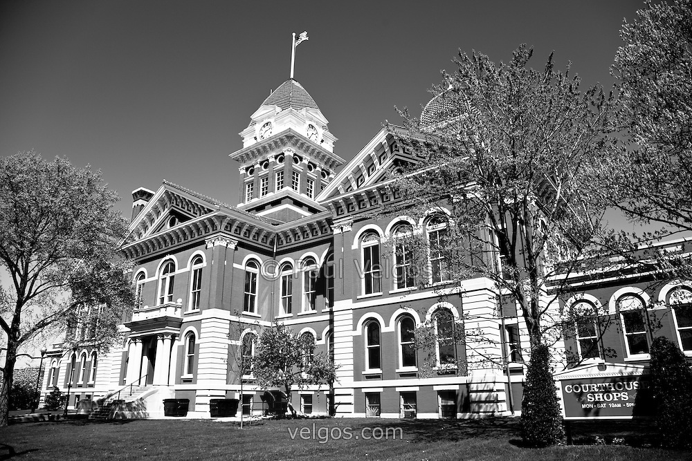 Crown Point Courthouse in black and white. The Lake County Courthouse was Built in 1878 and is nicknamed The Grand Old Lady. The courthouse architecture is Romanesque and Georgian. Today it's used for events and has a ballroom and restaurants.
