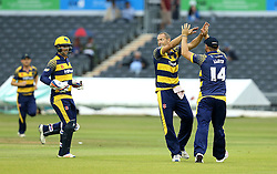 Dean Cosker of Glamorgan celebrates with David Lloyd of Glamorgan after taking the wicket of Benny Howell of Gloucestershire - Mandatory by-line: Robbie Stephenson/JMP - 10/06/2016 - CRICKET - Brightside Ground - Bristol, United Kingdom - Gloucestershire v Glamorgan - NatWest T20 Blast