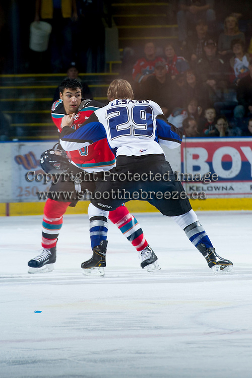 KELOWNA, CANADA - DECEMBER 5:  Tyrell Goulbourne #12 of the Kelowna Rockets drops the gloves with Tanner Lesann #29 of the Swift Current Broncos at the Kelowna Rockets on December 5, 2012 at Prospera Place in Kelowna, British Columbia, Canada (Photo by Marissa Baecker/Shoot the Breeze) *** Local Caption ***