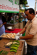 A vendor prepares to fry plantians at the Maricao Coffee Festival in the highlands of Puerto Rico.
