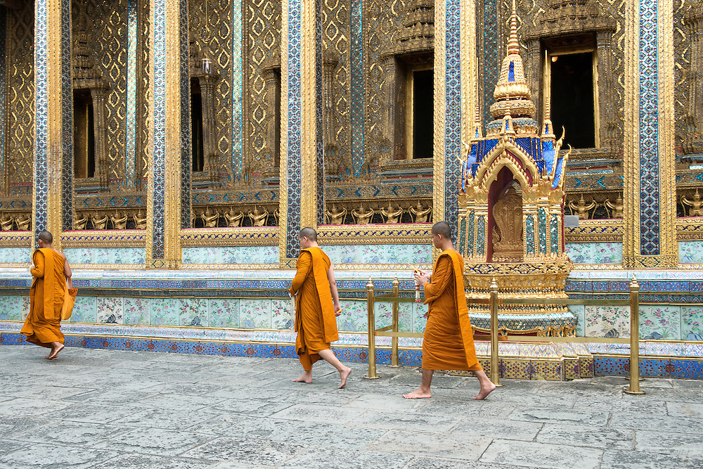 Buddhist Thai Monk walking in front of Wat Phra Kaew - Emerald Buddha Temple