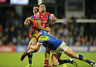 Brett Ferres (Captain) and Nathaniel Peteru of Leeds Rhinos tackle Derrell Olpherts (C) of Salford Red Devils during the Super 8s Qualifiers match at Emerald Headingley Stadium, Leeds<br /> Picture by Stephen Gaunt/Focus Images Ltd +447904 833202<br /> 14/09/2018