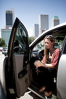 June 8, 2016 -- Amanda Goleman, 29, photographed in her car parked in downtown Tulsa, Oklahoma . Goleman is in danger of being arrested for debt.