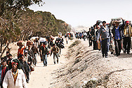 After leaving Libya, thousand of Bengladesh migrant workers walk to a transit camp in Choucha, 7 km from Tunisia's Ras Jdir border station.  04 March 2011 2011.