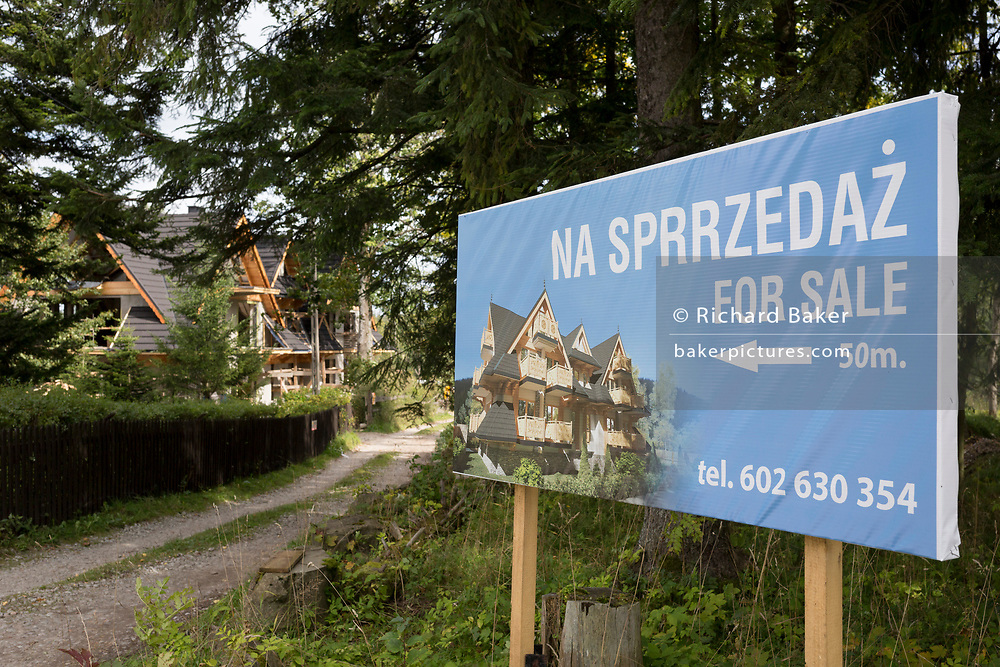 A local Polish building project for sale, on 16th September 2019, in Zakopane, Malopolska, Poland. Local wealth has encouraged tourism apartments and short-stay properties in the Zakopane and Tatra National Park region, a very popular outdoor activity destination for city-dwelling Poles.