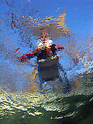 An underwater photo looking up at a lifeguard stand at Deep Eddy Pool in Austin Texas, December 30, 2008.  Deep Eddy Pool is the oldest swimming pool in Texas and features a bathhouse built by the Works Progress Administration in the 1930s.