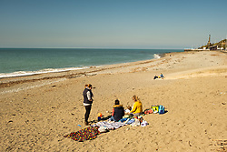©Licensed to London News Pictures. 28/03/2019. Aberystwyth, UK. People at the seaside in Aberystwyth Wales enjoying yet another day of bright spring sunshine.  High pressure continues to dominate the weather for much of the UK, with settled conditions and clear almost cloudless blue skies.<br />