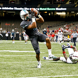 Sep 7, 2013; New Orleans, LA, USA; Tulane Green Wave wide receiver Ryan Grant (3) catches a touchdown over South Alabama Jaguars cornerback Montell Garner (16)during the second half of a game at the Mercedes-Benz Superdome. South Alabama defeated Tulane 41-39. Mandatory Credit: Derick E. Hingle-USA TODAY Sports