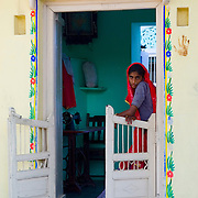 A young Rajasthani woman outside her sewing room in the village of Nimaj, Rajasthan.