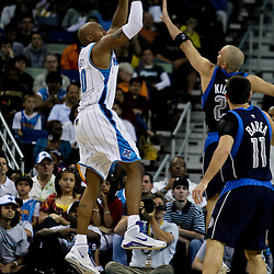 12 April 2009: New Orleans Hornets forward David West (30) shoots over Dallas Mavericks guard Jason Kidd (2) and guard Jose Juan Barea (11) during a 102-92 victory by the New Orleans Hornets over the Dallas Mavericks on Easter Sunday at the New Orleans Arena in New Orleans, Louisiana.