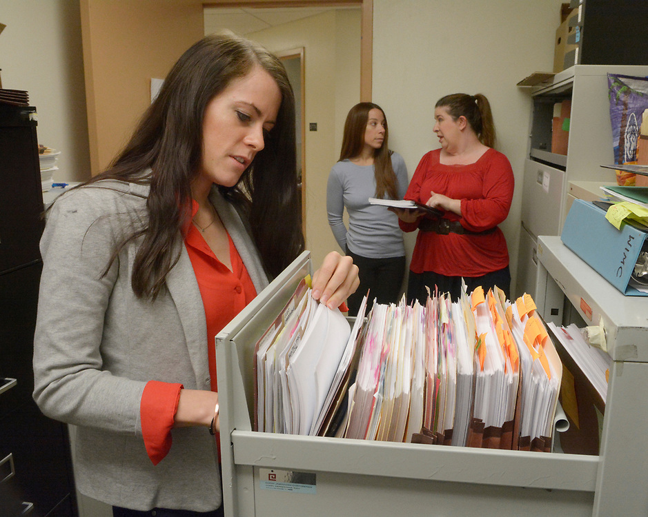 gbs030817c/LIVING -- Law students Margaret Kennedy, Skylar Hendi-Hubbard and paralegal Sara Escobedo, from left, work in the file room of current cases at the The New Mexico Innocence and Justice Project at the UNM Law School. (Greg Sorber/Albuquerque Journal)