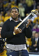 January 27, 2010: Iowa's Adrian Clayborn holds his 2009 National Defensive Performer of the Year trophy during halftime of a game at Carver-Hawkeye Arena in Iowa City, Iowa on January 27, 2010. Ohio State defeated Iowa 65-57.