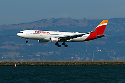 Airbus A330-202 (EC-MLP) operated by Iberia landing at San Francisco International Airport (KSFO), San Francisco, California, United States of America
