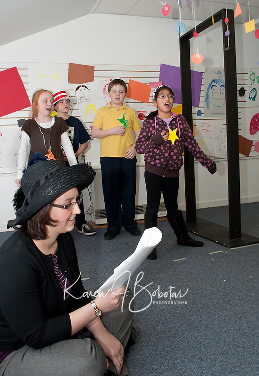 """Drame teacher Jen Bleiler narrates """"The Sneetches"""" while Willow Quindley, David Miville,  Jimmy Bushey and Maggie Mitchell prepare to go through the """"star off"""" machine as they perform for friends and family at the conclusion of Dr. Seuss Theater Camp with Winni Playhouse Friday morning in Meredith.   (Karen Bobotas/for the Laconia Daily Sun)"""