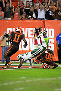 Cleveland Browns rookie wide receiver Antonio Callaway (11) looks on as Cleveland Browns wide receiver Jarvis Landry (80) gets upended as he catches a third quarter pass for a gain of 29 yards and a first down with goal to go at the Jets 1 yard line while covered by New York Jets defensive back Doug Middleton (36) during the 2018 NFL regular season week 3 football game against the New York Jets on Thursday, Sept. 20, 2018 in Cleveland. The Browns won the game 21-17. (©Paul Anthony Spinelli)