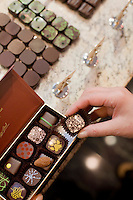 24 October, 2008. New York, NY. Owner Namhee Girerd Kim, 53, picks an assortment of bon bons and fills a box at the boutique &quot;L'atelier du chocolat&quot;. The chocolates are made by her husband, Eric Girerd.<br /> NOTE: Since no customers were at the shop, the subject posed for the photographer.<br /> &copy;2008 Gianni Cipriano for The New York Times<br /> cell. +1 646 465 2168 (USA)<br /> cell. +1 328 567 7923 (Italy)<br /> gianni@giannicipriano.com<br /> www.giannicipriano.com