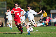 Essex's Brennan Goodrich (23) kicks the ball down the field past CVU's Will Yakibuk (21) during the boys soccer game between the Champlain Valley Union Redhawks and the Essex Hornets at Essex High School on Saturday mooring October 10, 2015 in Essex. (BRIAN JENKINS/For the FREE PRESS)