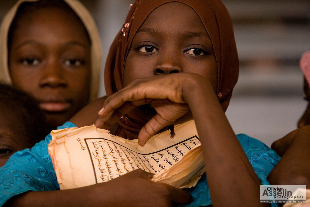 Girl holding Arabic manuscripts at the Mame Diarra Bousso koranic school in the village of Porokhane, Senegal, on Monday June 18, 2007.
