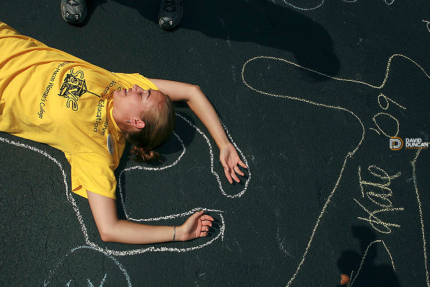Jennifer Charest a senior at Randolph-Macon Woman's college in Lynchburg, VA has her body outlined on the  pavement after Jolley Christman, President of the Board of Trustees at Randolph-Macon Woman's College announced Saturday August 9, 2006 that the college would admit men in 2007..Photo by David Duncan.