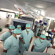 June 2007 - Prof. Didier Martin removes a tumor from the brain of a patient at the Belgian University Hospital of Liege. Brain tumor resection under neuronavigation and intraoperative magnetic resonance imaging. The tumor is located in the right frontal lobe. It induces mood modifications and left hemiparesis. The resection is performed with an ultrasonic aspirator and is guided by a high-precision neuronavigation device. The quality of the resection is controlled by the acquisition of intraoperative magnetic resonance images. ©Jean-Michel Clajot