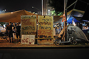 TEL AVIV, ISRAEL - JULY 25, 2011: Israelis attend the demonstration tent camp in Tel Aviv, demonstrating agains rising housing prices. Over the past two weeks, Israelis have set up tent camps in many cities throughout Israel, and protested calling attention to the rising cost of living. ss