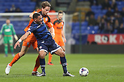 Bolton Wanderers midfielder Liam Feeney and Christophe Berra, Ipswich Town defender battle for the ball during the Sky Bet Championship match between Bolton Wanderers and Ipswich Town at the Macron Stadium, Bolton, England on 8 March 2016. Photo by Simon Brady.