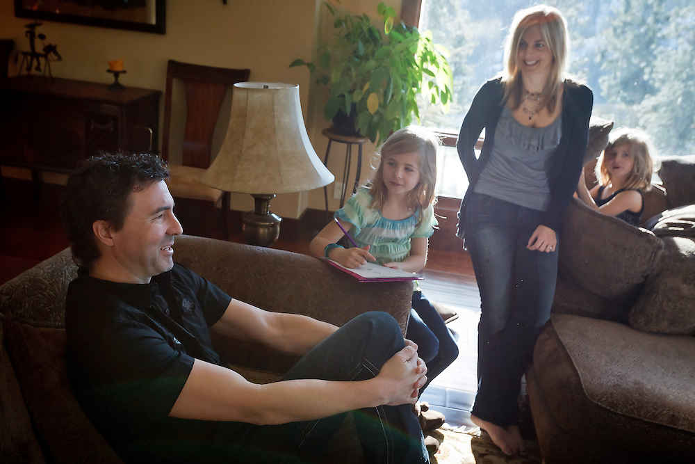 Tom Torgerson discusses his recovery and the support he received from friends and family after he fell from a ladder Oct. 20. Torgerson is still recovering from a massive head injury he sustained in the fall with the help of his family and friends. Also photographed are his wife KJ Torgerson and their daughters Taylor, 5, right, and Riley 7.