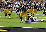 September 24, 2011: Iowa Hawkeyes wide receiver Keenan Davis (6) tries to pull away from Louisiana Monroe Warhawks cornerback Vincent Eddie (27) towards the end zone after a catch during the first quarter of the game between the Iowa Hawkeyes and the Louisiana Monroe Warhawks at Kinnick Stadium in Iowa City, Iowa on Saturday, September 24, 2011. Iowa defeated Louisiana Monroe 45-17.