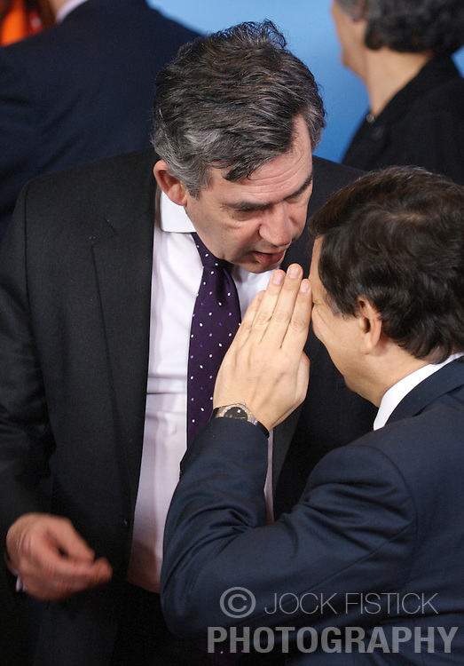 """BRUSSELS, BELGIUM - MARCH-13-2008 - Gordon Brown, Prime Minister of Great Britain, left, speaks with Jose Manuel Barroso, President of the European Commission, as European heads of state gather for the  """"Family Photo"""" during the European Summit, in Brussels, Belgium, Thursday, March 13, 2008.  (Photo  © Jock Fistick)"""