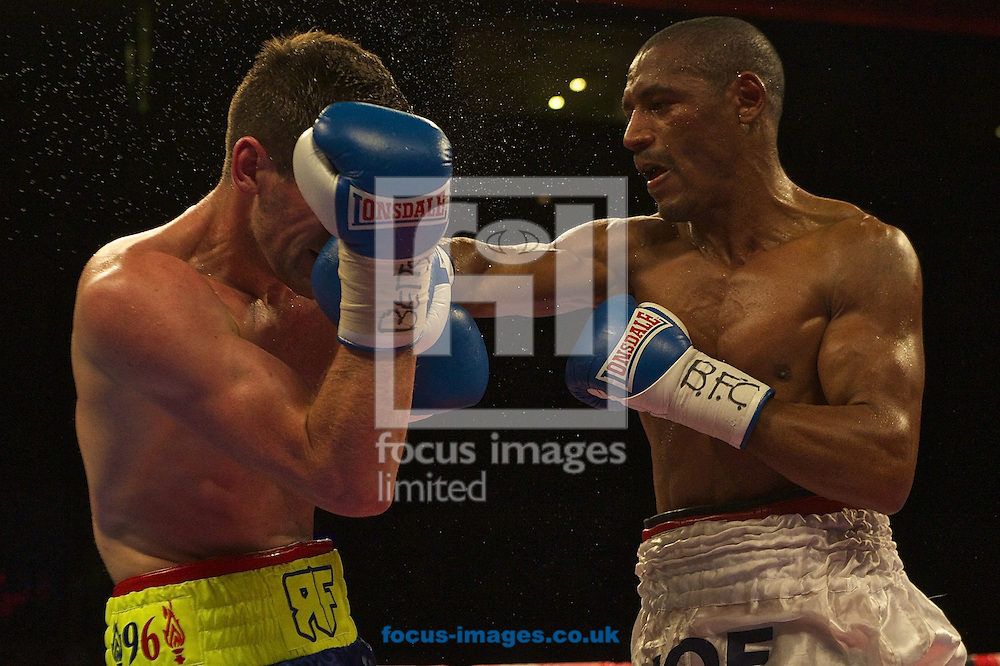 Rocky Fielding (blue shorts) and Noe Gonzalez-Alcoba (white shorts) during their bout for the vacant WBA Inter-Continental Super-Middleweight Title at Echo Arena, Liverpool<br /> Picture by Ian Wadkins/Focus Images Ltd +44 7877 568959<br /> 12/07/2014