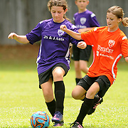 Katelyn Fuller, left, 10, challenges Anna Duckworth, 12, during a Port City Soccer match Saturday September 6, 2014 at Olsen Farm Fields. (Jason A. Frizzelle)