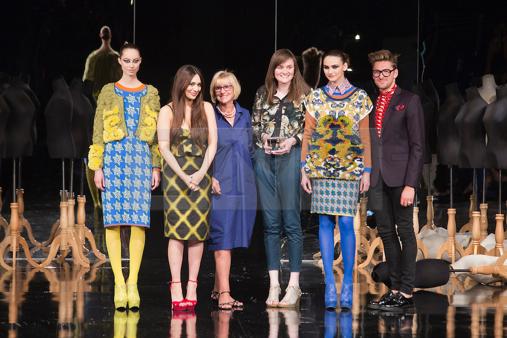 © Licensed to London News Pictures. 05/06/2013. London, England. THEA SAUNDERS of Nottingham Trent University wins the Stuart Peters Visionary Knitwear Award. Pictured with Erica Peters, Zara Martin and Henry Holland. Award winners of Graduate Fashion Week 2013. Photo credit: Bettina Strenske/LNP