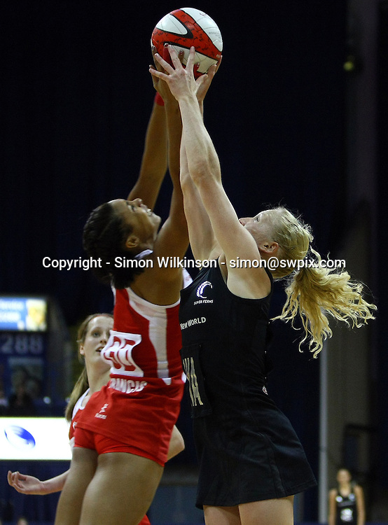 PICTURE BY VAUGHN RIDLEY/SWPIX.COM...Netball - International Netball Series - England v New Zealand - Capital FM Arena, Nottingham, England - 17/01/11...New Zealand's Laura Langman and England's Stacey Francis battle for the ball.