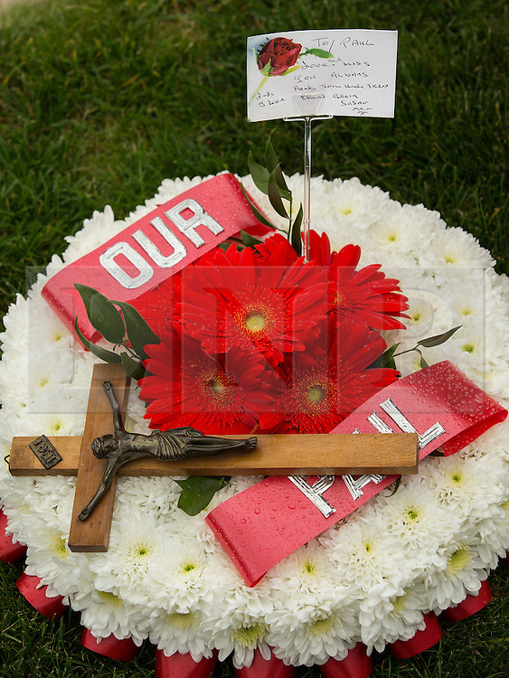 """© Licensed to London News Pictures . 28/08/2015 . Salford , UK . Flowers and tribute left on Sedan Close in Salford , from where the procession sets off . The funeral of Paul Massey at St Paul's CE Church in Salford . Massey , known as Salford's """" Mr Big """" , was shot dead at his home in Salford last month . Photo credit : Joel Goodman/LNP"""