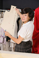 Fashion designer working in cloth design store