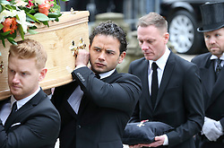 © Licensed to London News Pictures . 18/03/2016 . Manchester , UK . L to R Mikey North and Ryan Thomas carrying the coffin, followed by Antony Cotton carrying Tony Warren's mbe. Television stars and members of the public attend the funeral of Coronation Street creator Tony Warren at Manchester Cathedral . Photo credit : Joel Goodman/LNP